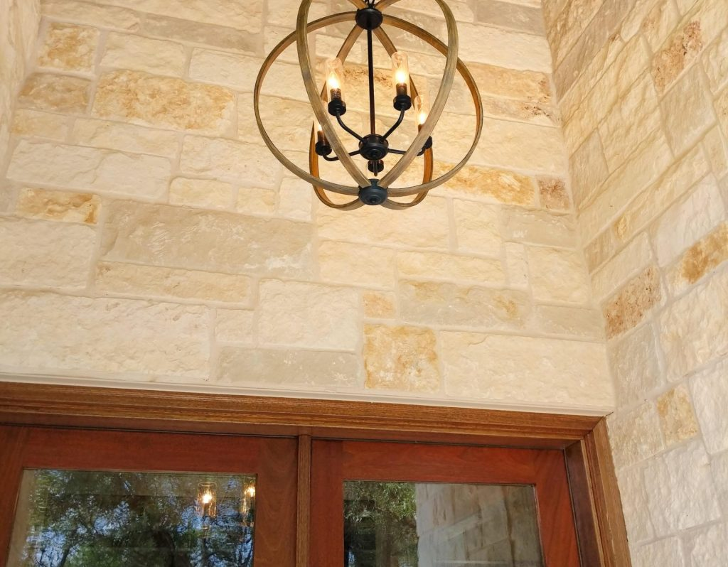 stained wood front doors with entry light