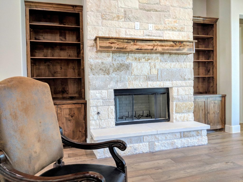 stained wood trim and stone fireplace